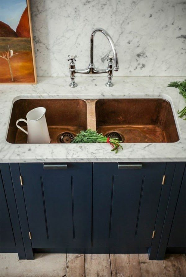 Love these marble and navy blue kitchen cabinets