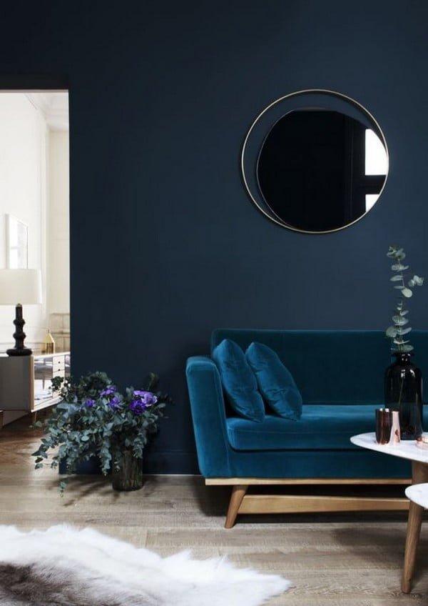 Love the navy blue interior and deep blue velvet sofa