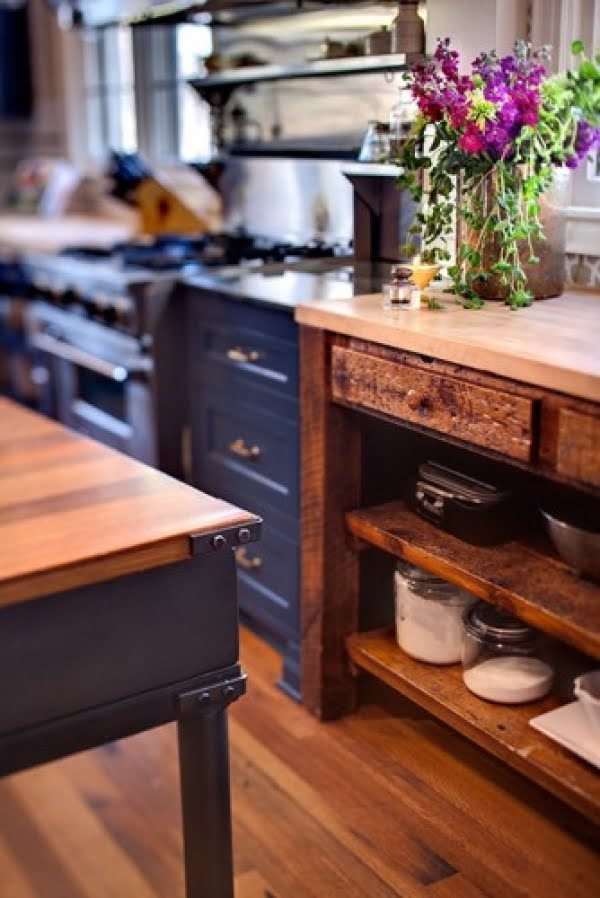 Love the combination of navy blue cabinets and rustic wood tables