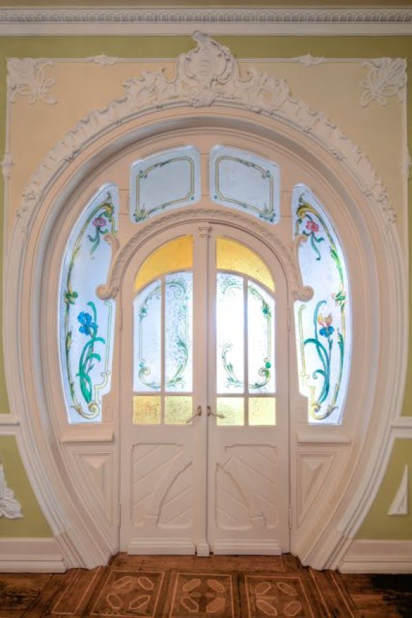 A unique shaped door with classic moldings and stained glass in a palace in Lisbon @Istandarddesign