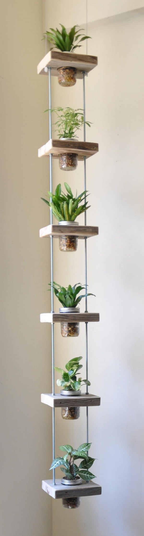 Check out how to build this DIY vertical jar herb garden