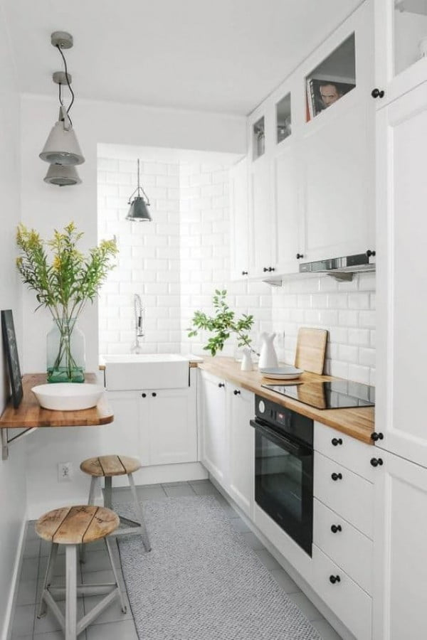 Love this small  decor. The butcher block countertops work so well with subway tiles to bring it home