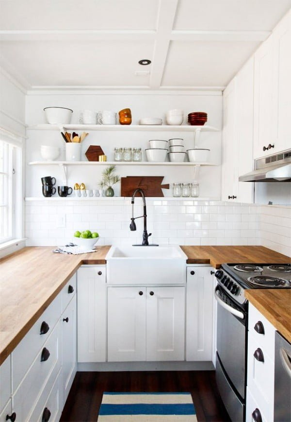 Tiny #kitchen decor made big by wood countertops and subway tile. Love it! #homedecor