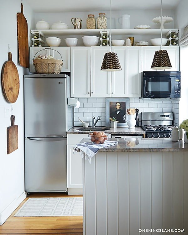 Yes, that's a painting against a subway tile backslash. Love all the detail in this tiny #kitchen decor! #homedecor