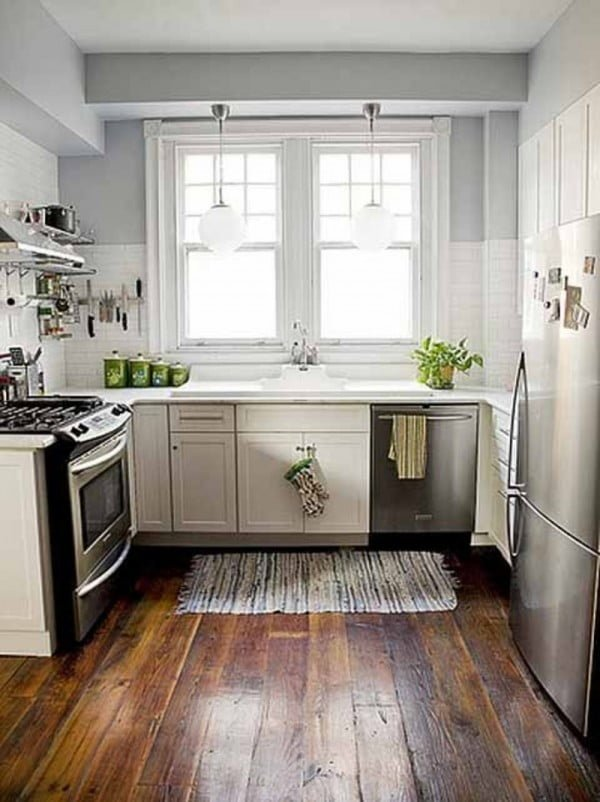 This #kitchen is so classy. Love the metallic details and moldings around the windows! #homedecor