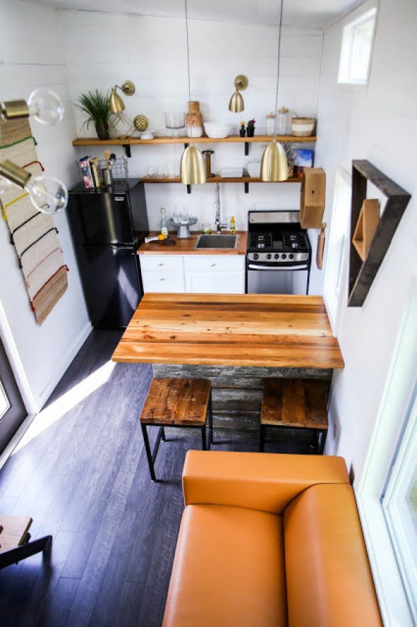 Here's what some  wood accents can do with a small . Wood countertops and shelves with copper pendants. Love it!