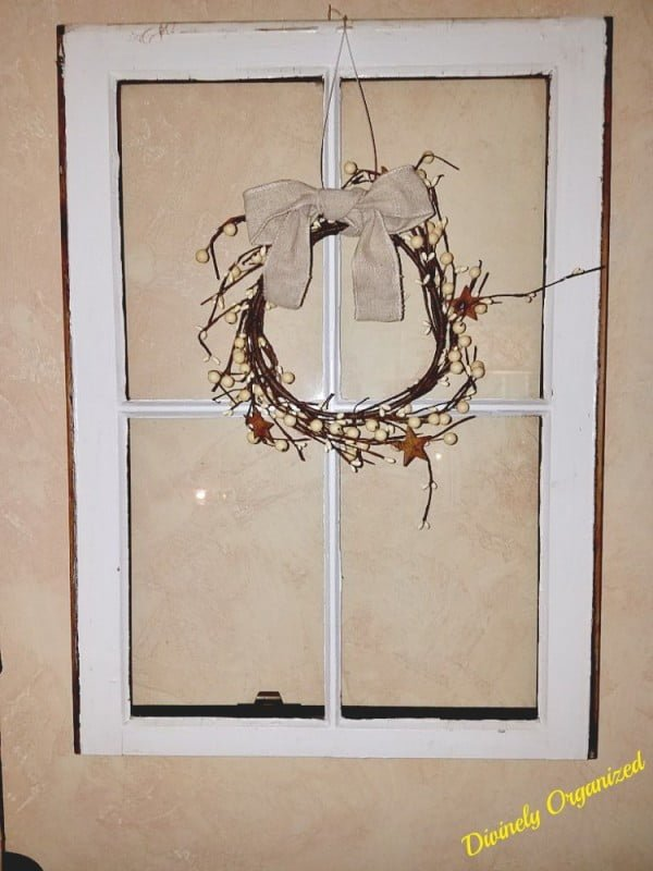 Check out the tutorial how to make a DIY decorative wreath from an old window