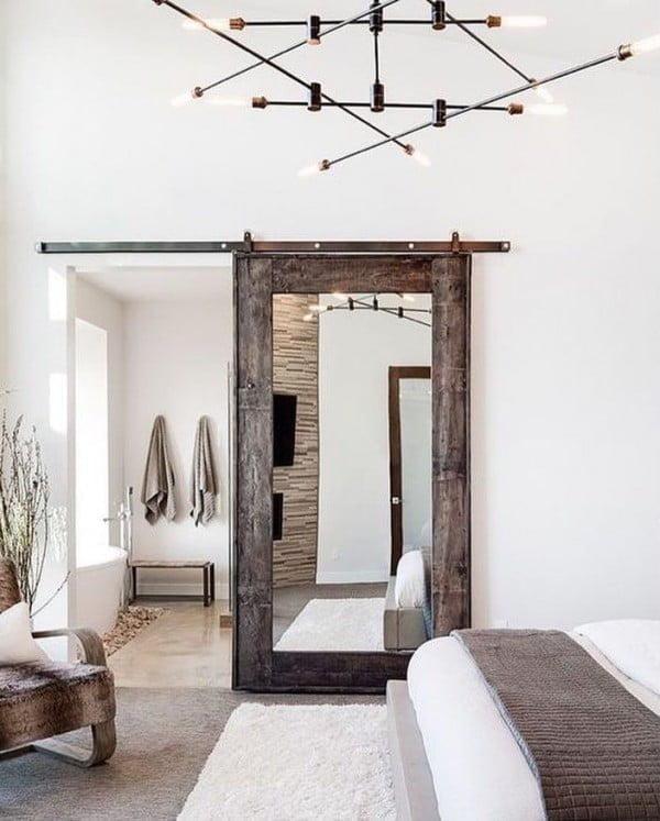 Great bedroom decor idea with  style barn door mirror. Love it!