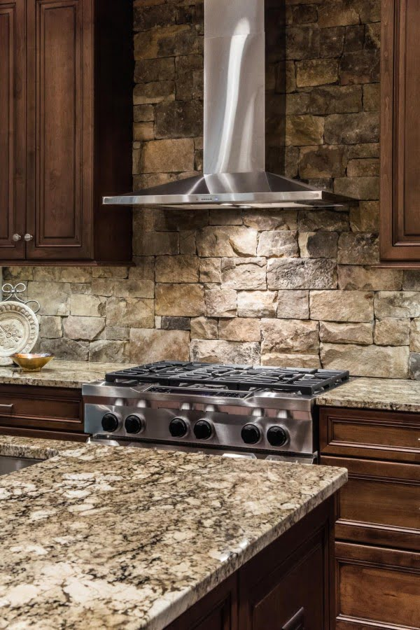 countertops and exposed stone walls work just so well in this  decor!