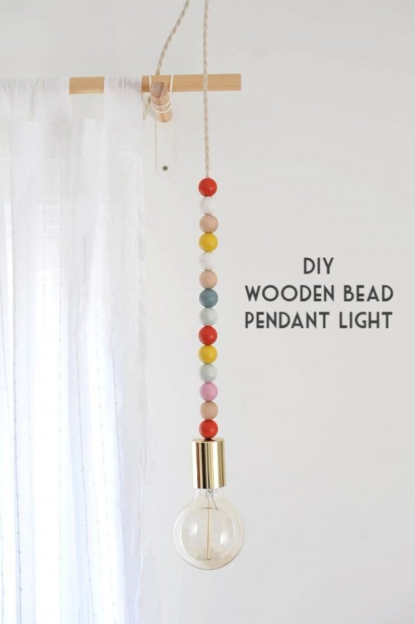 Check out this easy idea on how to make a #DIY wooden bead light #DIYHomeDecor #HomeDecorIdeas