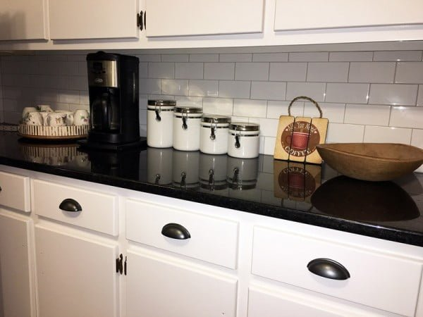 Black pearl  countertops and subway tiles. Love it!