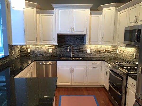 Uba Tuba color #granite countertops work so well with white cabinets. Awesome #kitchen decor!