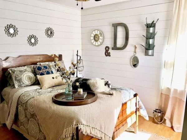 Rustic bedroom with planked walls. Love the  style!