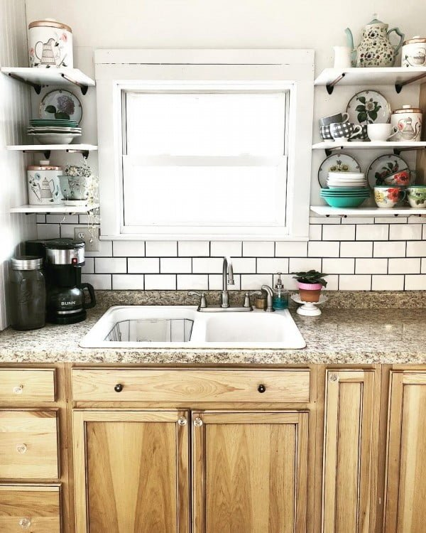 Subway tiles, wood cabinets, granite countertops and  shelves. I'm in love!