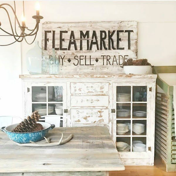Vintage signs can make or break  decor. In this case it works perfectly. Love it!