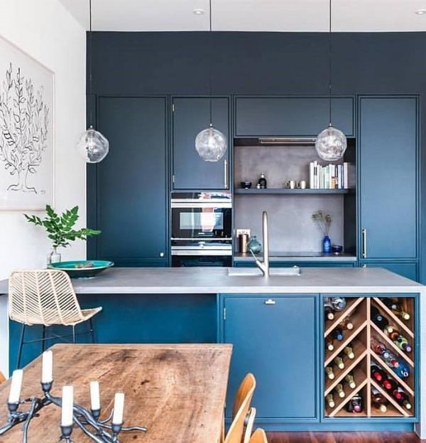 You have to see these dark blue kitchen cabinets with rustic accents. Love it!