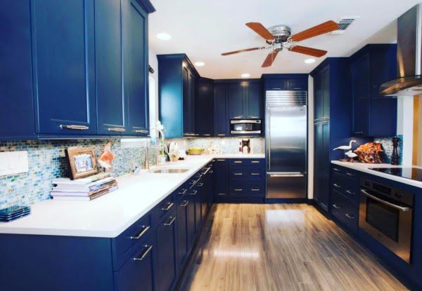 You have to see these blue kitchen cabinets with white countertops. Love it!