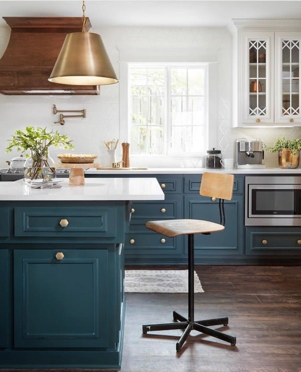 You have to see these blue kitchen cabinets with natural wood and metallic accents. Love it!