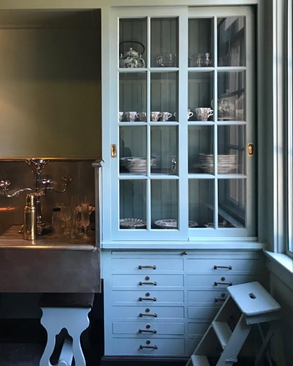 You have to see these soft blue kitchen cabinets with glass doors. Love it!