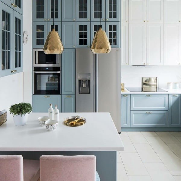 You have to see these soft blue kitchen cabinets with metallic accents and pops of rose gold. Love it! #KitchenDesign #HomeDecorIdeas