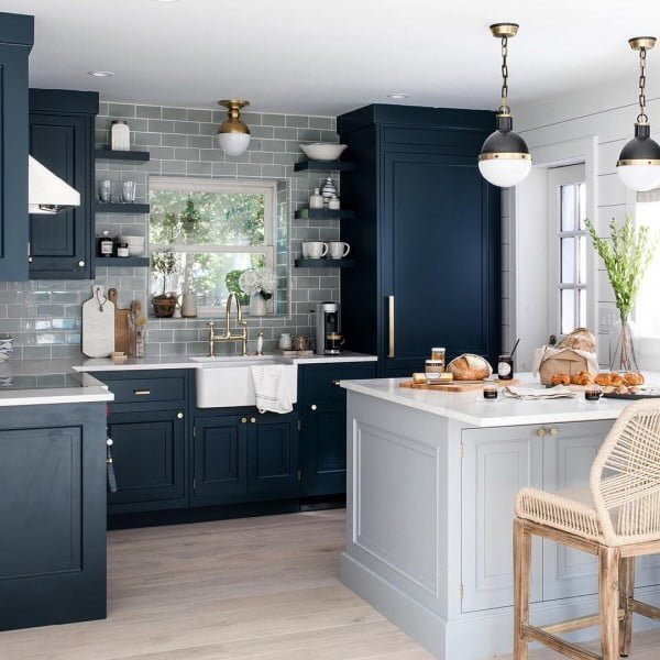 You have to see these blue kitchen cabinets with grey subway tile. Love it!