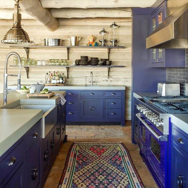 You have to see these blue kitchen cabinets with  decor. Love it!