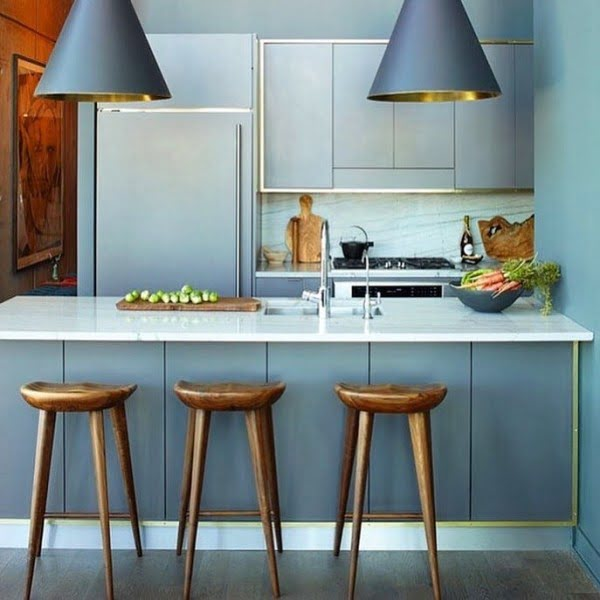 You have to see these blue kitchen cabinets with rustic and metallic accents. Love it!