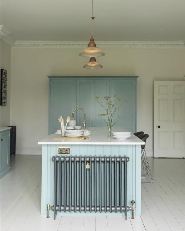 You have to see these soft blue kitchen cabinets with white walls. Love it!