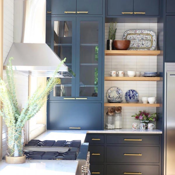 You have to see these blue kitchen cabinets with natural wood accents. Love it!