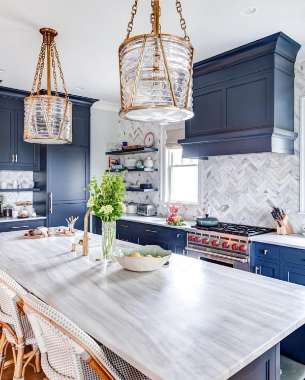 You have to see these blue kitchen cabinets with herringbone walls. Love it! #KitchenDesign #HomeDecorIdeas
