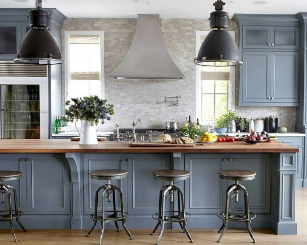 You have to see these blue kitchen cabinets with metallic accents. Love it!