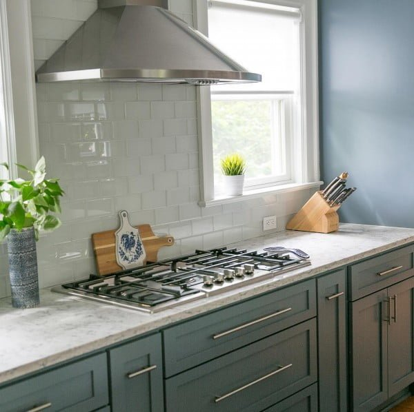 You have to see these blue kitchen cabinets with slate blue walls. Love it!