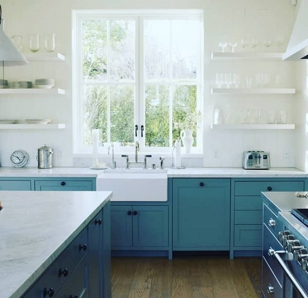 You have to see these aqua blue kitchen cabinets with marble countertops. Love it!