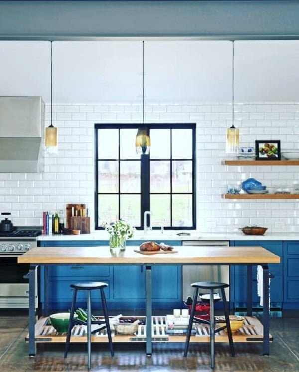 You have to see these blue kitchen cabinets with subway tile walls. Love it!