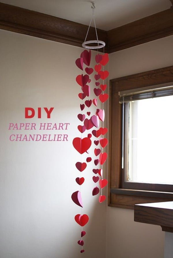 Check out this easy idea on how to make a #DIY paper heart garland for #ValentinesDayDecor #ValentinesDayCrafts #ValentinesIdeas