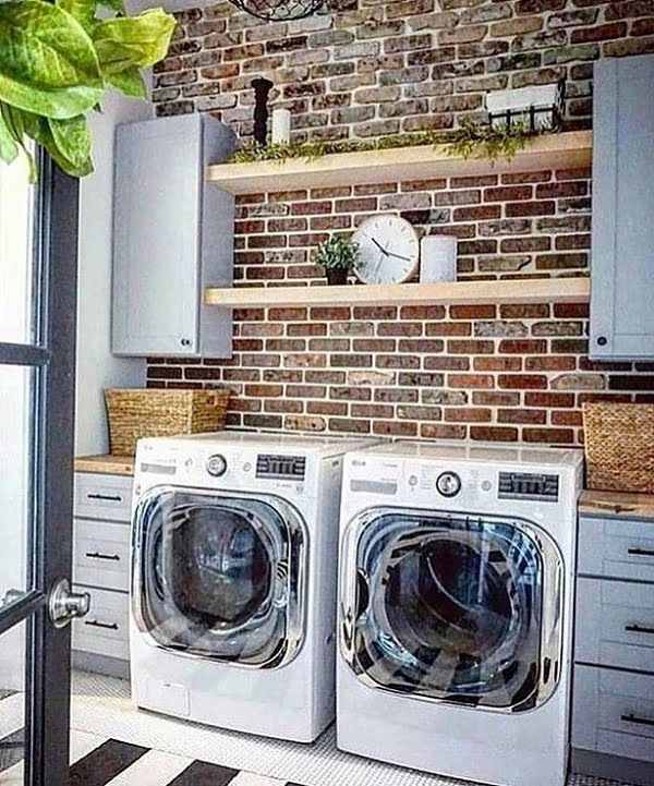 Check out this laundry room decor idea with exposed brick wall. Brilliant! #LaundryRoomDesign #HomeDecorIdeas