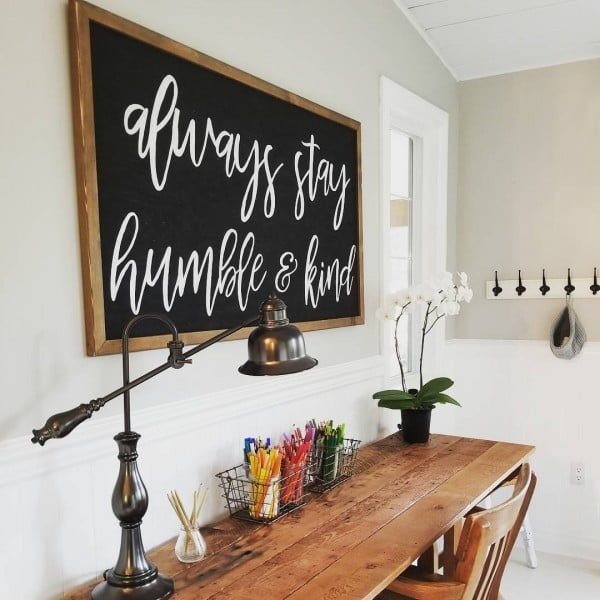 100 Charming Farmhouse Decor Ideas for Your Home Office - Check out this #farmhouse style home office decor with a rustic wood plank tabletop and sign wall art. Love it! #HomeDecorIdeas #HomeOfficeIdeas #FarmhouseStyle