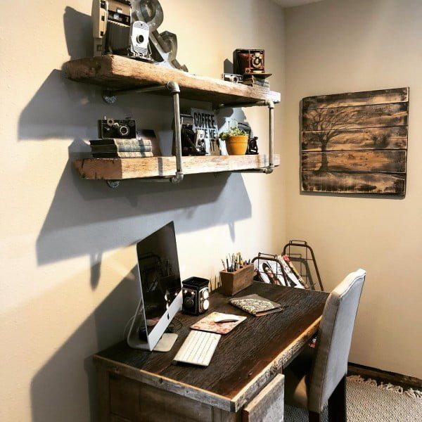 100 Charming Farmhouse Decor Ideas for Your Home Office - Check out this #farmhouse style home office decor with rustic piping shelves. Love it! #HomeDecorIdeas #HomeOfficeIdeas #FarmhouseStyle