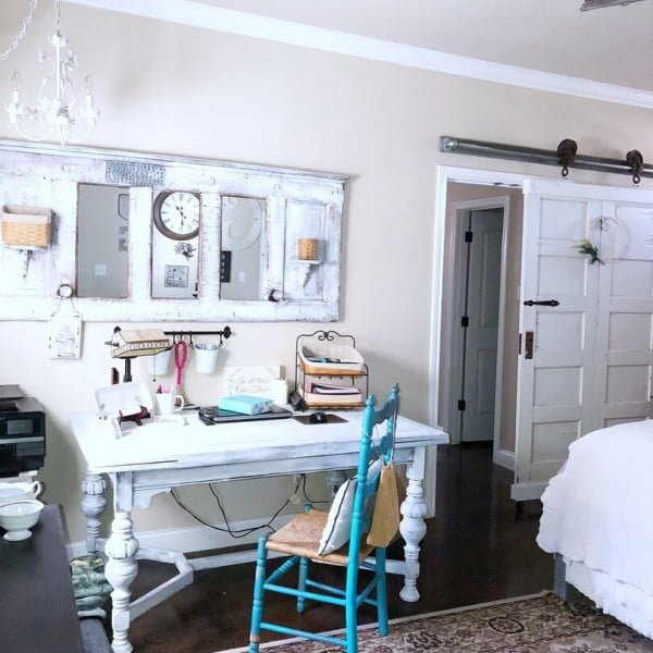 100 Charming Farmhouse Decor Ideas for Your Home Office - Check out this #farmhouse style home office decor with sliding barn doors. Love it! #HomeDecorIdeas #HomeOfficeIdeas #FarmhouseStyle