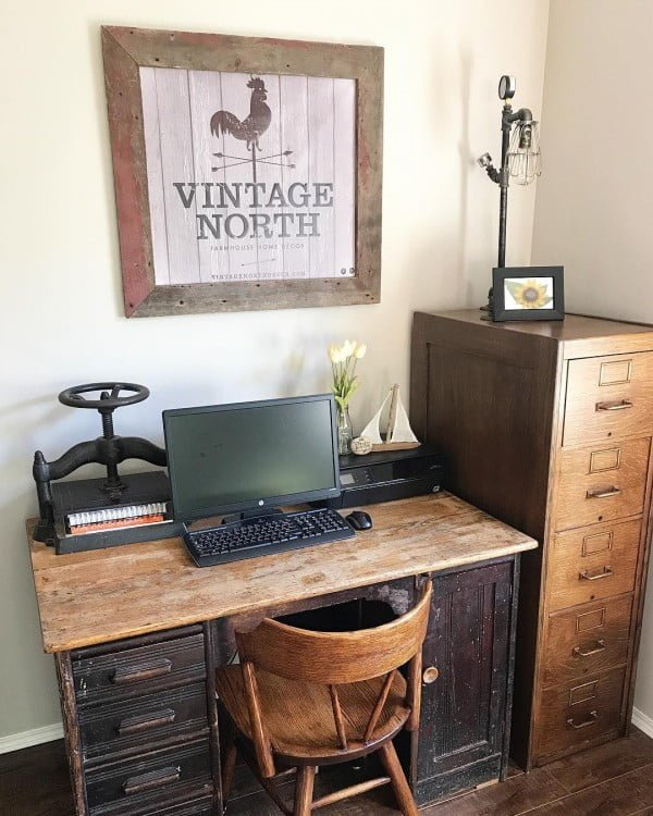 100 Charming Farmhouse Decor Ideas for Your Home Office - Check out this #farmhouse style home office decor with a rustic desk and file cabinet. Love it! #HomeDecorIdeas #HomeOfficeIdeas #FarmhouseStyle