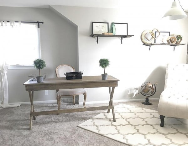 100 Charming Farmhouse Decor Ideas for Your Home Office - Check out this #farmhouse style home office decor with a rustic table and reclaimed wood shelves. Love it! #HomeDecorIdeas #HomeOfficeIdeas #FarmhouseStyle