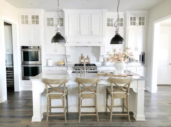 Check out this #farmhouse #kitchen decor idea with awesome wood chairs. Love it! #KitchenDecor #HomeDecorIdeas
