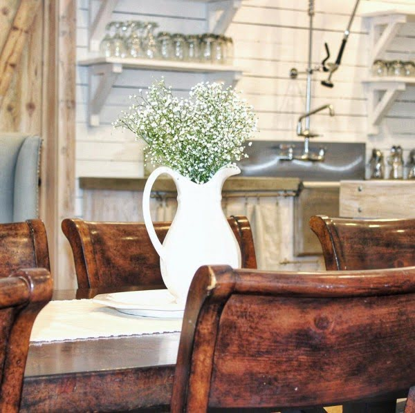 Check out this #farmhouse #kitchen decor idea with natural wood dining set. Love it! #KitchenDecor #HomeDecorIdeas