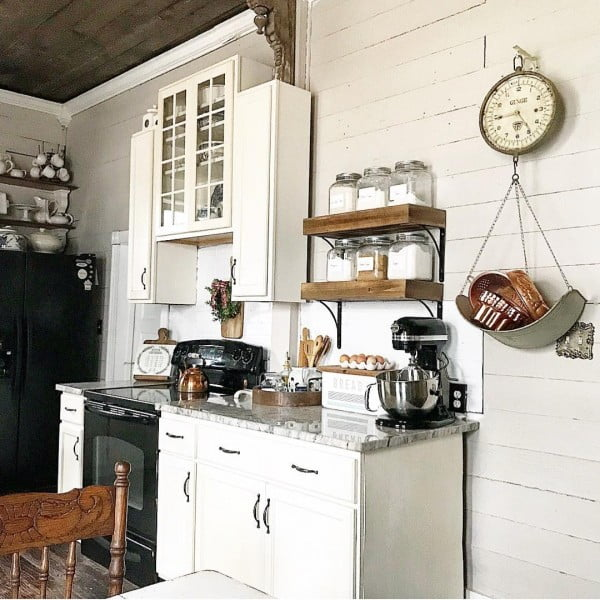 100 Stunning Farmhouse Kitchen Decor Ideas You Have to Try - The vintage clock makes the perfect accent in this #farmhouse #kitchen decor. Love it! #KitchenDecor #HomeDecorIdeas