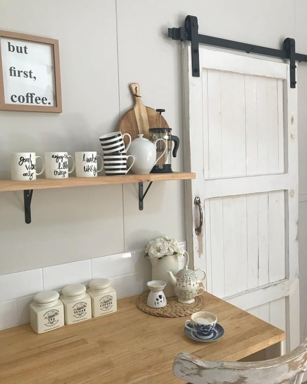 A barn door is a must. Love this! #farmhouse #kitchen #KitchenDecor #HomeDecorIdeas