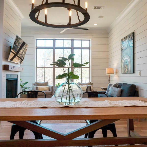100 Stunning Farmhouse Kitchen Decor Ideas You Have to Try - Shiplap walls and a  chandelier complements great dining area decor. Love it!