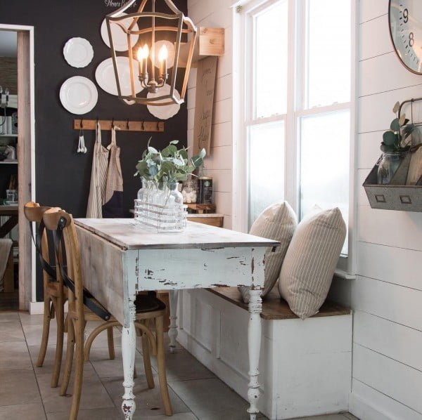 100 Stunning Farmhouse Kitchen Decor Ideas You Have to Try - A white distressed table can do wonders to #farmhouse #kitchen decor. Love this! #KitchenDecor #HomeDecorIdeas
