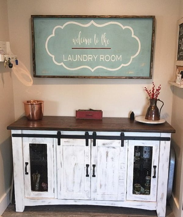 100 Fabulous Laundry Room Decor Ideas You Can Copy - Check out this laundry room decor idea with #FarmhouseDecor sign. Love it! #LaundryRoomDesign #HomeDecorIdeas