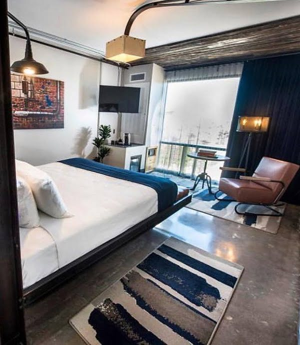 Great sleeping area in the industrial style. Love the floating bed design! #BedroomIdeas #BedroomDecor #HomeDecorIdeas