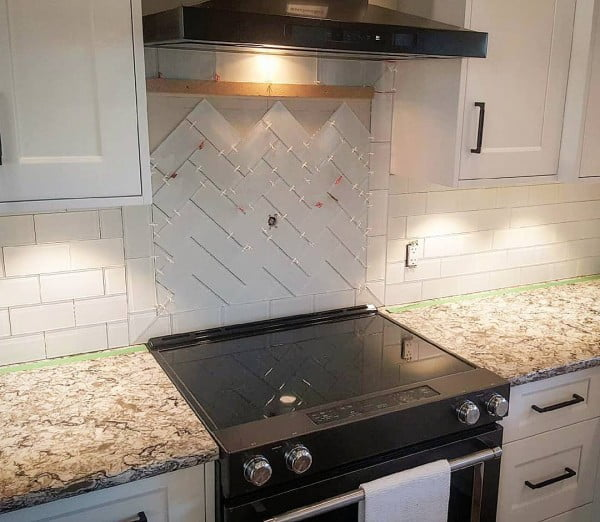 Check out this herringbone tile  and the brilliant . Love it!